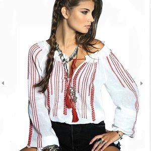 White top with red embroidery